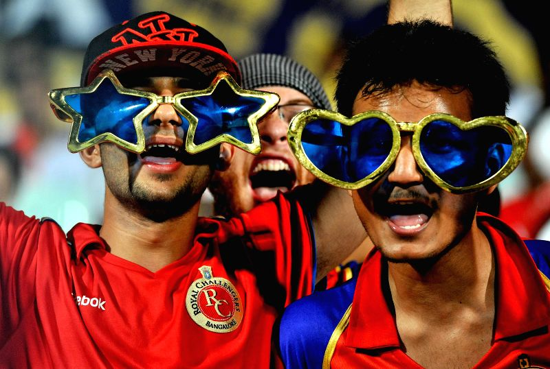Fans cheer during an IPL-2015 match between Kolkata Knight Riders (KKR) and Royal Challengers Bangalore (RCB) at Eden Gardens in Kolkata on April 11, 2015.