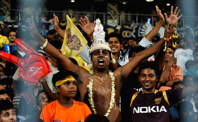 Fans cheer during an IPL-2015 match between Chennai Super Kings and Kolkata Knight Riders in Kolkata, on April 30, 2015.