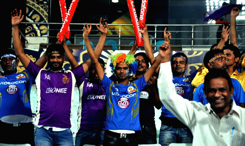 Fans cheer during an IPL-8 2015 match between Kolkata Knight Riders (KKR) and Mumbai Indians (MI) at the Eden Gardens in Kolkata on April 8, 2015.