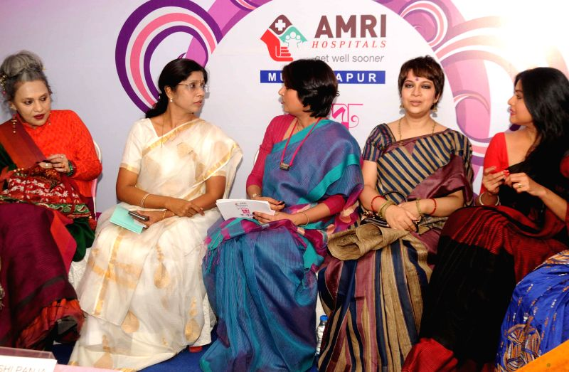 Fashion designer Sharbari Dutta, Dancer Alkananda Roy, Trinamool leader Dr Shashi Panja, actress Churni Ganguly, and others during a program on International Women's Day in Kolkata on March ... - Churni Ganguly and Alkananda Roy