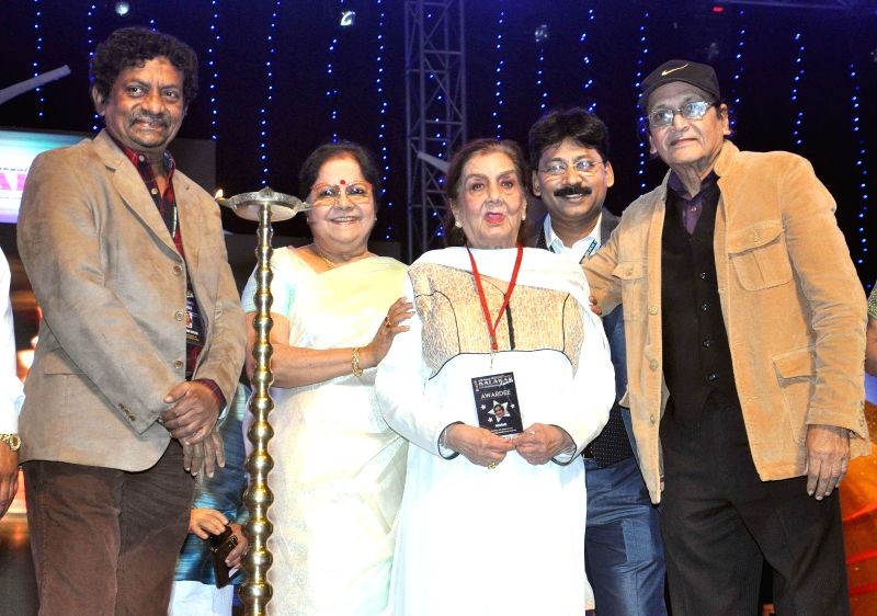 Filmmaker Goutam Ghosh, vetaran actors Lily Chakraborty, Nimmi, Biswajit Chatterjee during the 23rd Kalakar Awards in Kolkata on Jan 11, 2014. - Goutam Ghosh, Lily Chakraborty, Nimmi and Biswajit Chatterjee