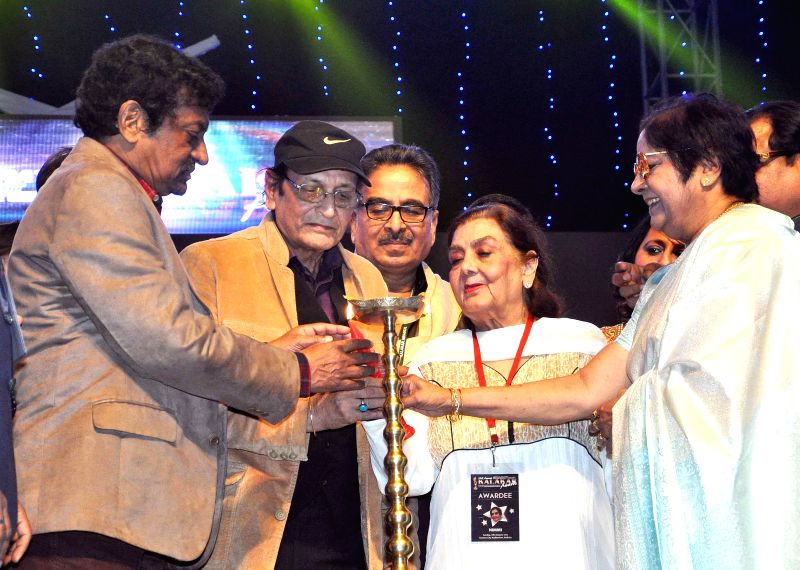 Filmmaker Goutam Ghosh, vetaran actors Biswajit Chatterjee, Nimmi, Lily Chakraborty at the inauguration of the 23rd Kalakar Awards in Kolkata on Jan 11, 2014. - Goutam Ghosh, Biswajit Chatterjee, Nimmi and Lily Chakraborty