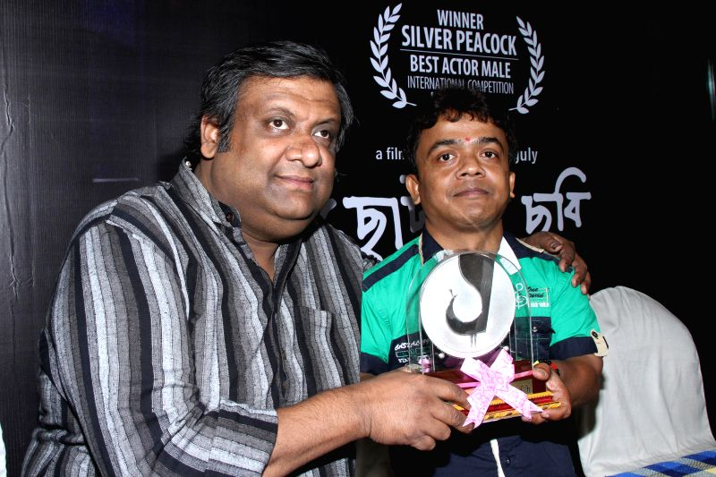 """Filmmaker Kaushik Ganguli and actor Dulal Sarkar,who recently won best actor award for his role in Bengali film """"Chhotoder Chhobi"""" at the 45th International Film Festival of India ."""