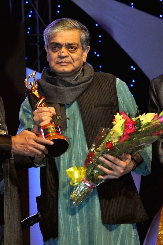 Filmmaker Sandip Ray receives Best Director Award during the 23rd Kalakar Awards in Kolkata on Jan 11, 2014. - Sandip Ray