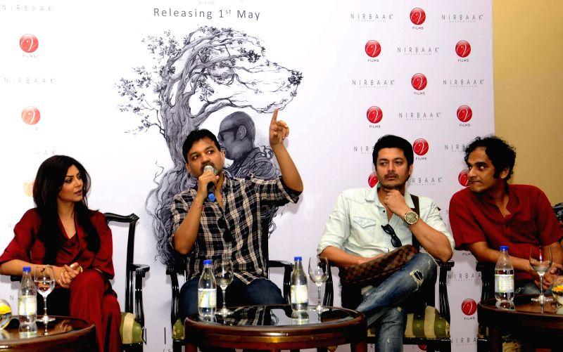 Filmmaker Srijit Mukherji with actors Sushmita Sen, Jisshu Sengupta and Ritwick Chakraborty  during a press conference regarding their upcoming film `Nirbaak` in Kolkata, on April 29, 2015. - Srijit Mukherji, Sushmita Sen, Jisshu Sengupta and Ritwick Chakraborty