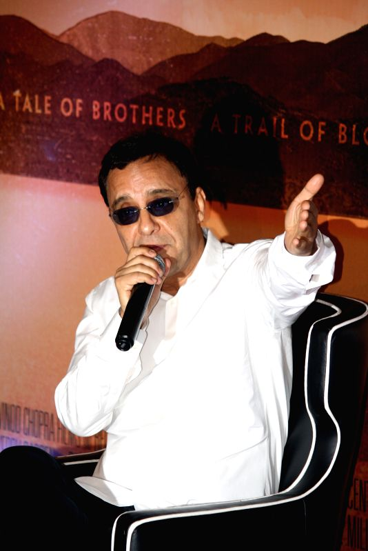 Filmmaker Vidhu Vinod Chopra addresses a press conference regarding his upcoming Hollywood film `Broken Horses` in Kolkata on April 6, 2015. - Vidhu Vinod Chopra