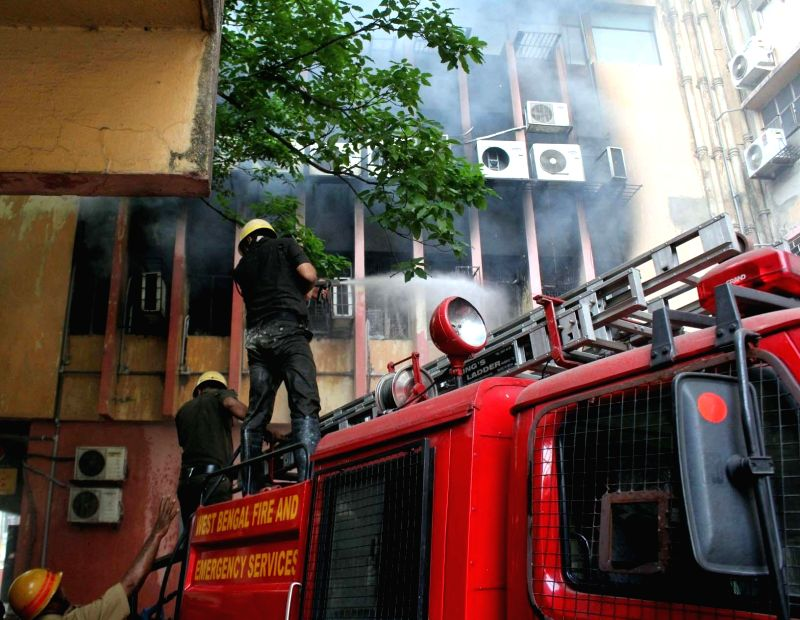 Fire fighters douse a fire that broke out at Santiniketan building in Kolkata, on March 10, 2015.