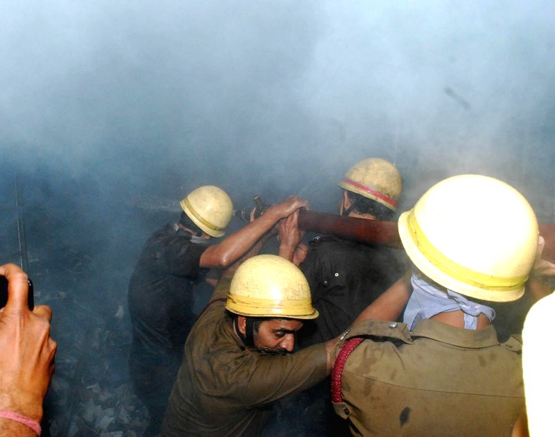 Fire fighters try hard to douse a fire that broke out at a plastic godown in Kasba of Kolkata on March 1, 2015.