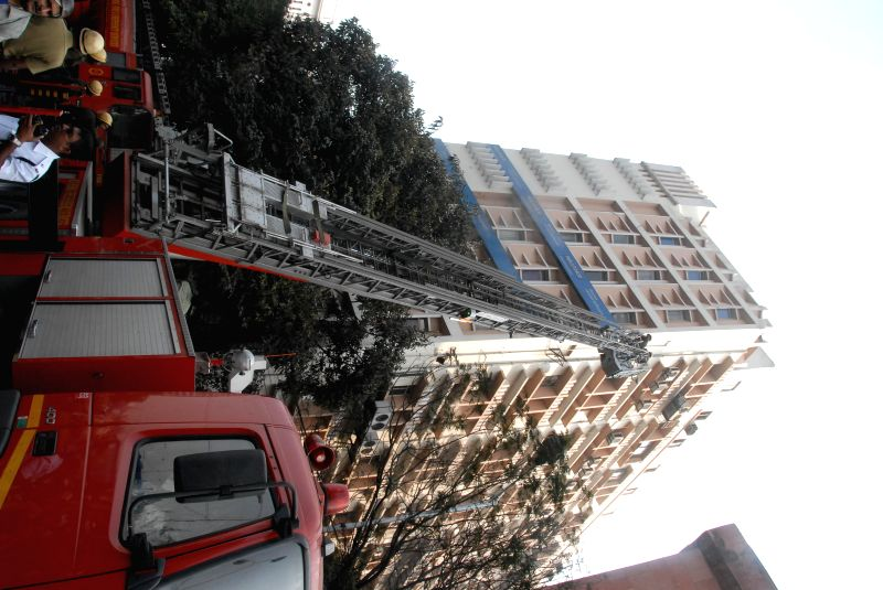 Firefighters try hard to douse a fire that broke out at Himalaya House in Kolkata on Feb. 5, 2015.