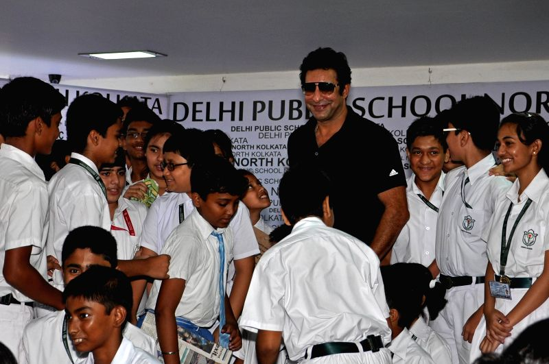 Formar Pakistani cricketer Wasim Akram with school children during a program in Kolkata on May 5, 2015.