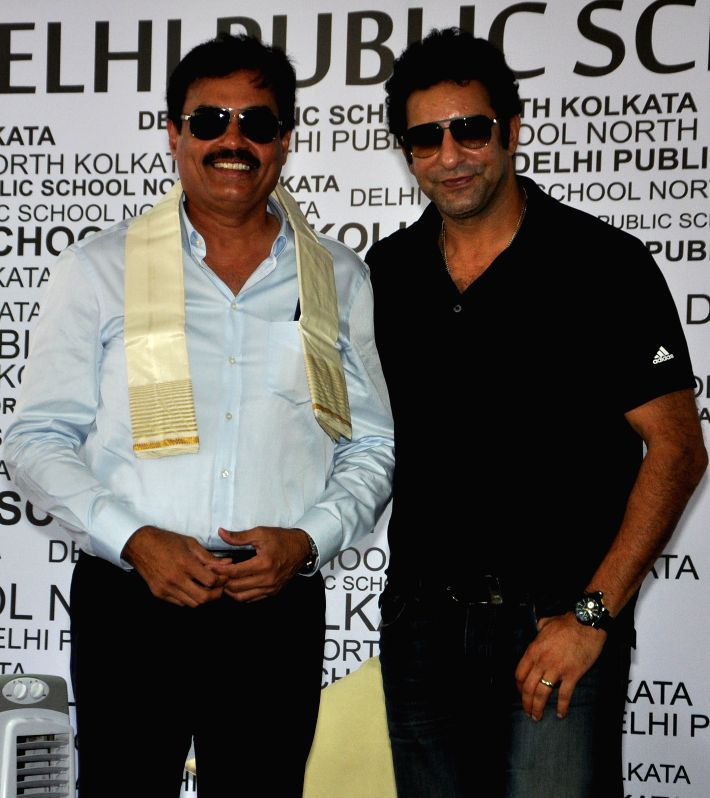 Formar Pakistani cricketer Wasim Akram and Indian cricketer Dilip Vengsarkar during a program at a school in Kolkata on May 5, 2015.