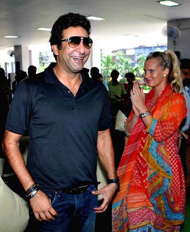 Formar Pakistani cricketer Wasim Akram with his wife during a program at a school in Kolkata on May 5, 2015.