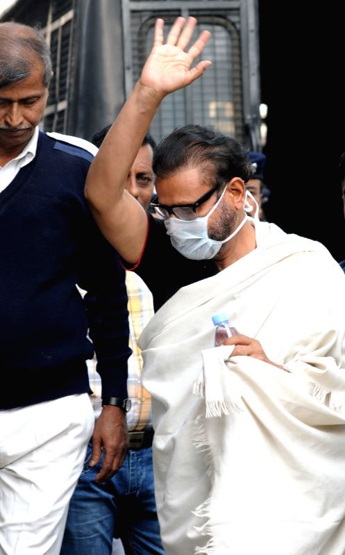 Former Congress minister Matang Singh being taken to be produced in a Kolkata court in connection with the multi-crore-rupee Sardha chit fund scam on Feb 7, 2015.