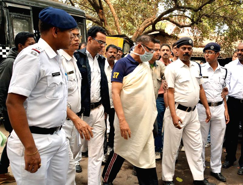 Former Congress minister Matang Sinh being taken to be produced in a Kolkata court in connection with the multi-crore-rupee Sardha chit fund scam on Feb 15, 2015.