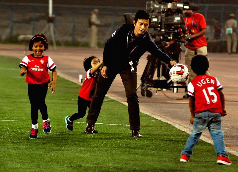 Former footballer Baichung Bhutia with his children ahead of an ISL match between Atletico de Kolkata and Chennaiyin FC at Salt Lake Stadium in Kolkata on Nov 14, 2014.