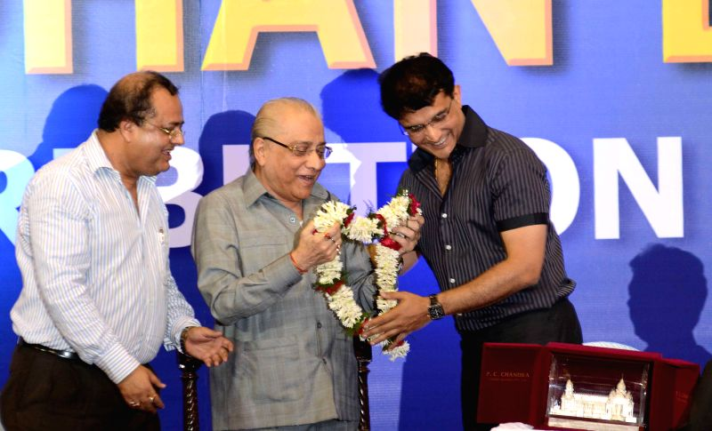 Former Indian cricketer Sourav Ganguly felicitates BCCI president Jagmohan Dalmia during a CAB programme in Kolkata on April 2, 2015. - Sourav Ganguly