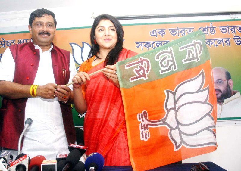 Former Trinamool Congress leader Locket Chatterjee joins BJP in presence of West Bengal BJP chief Rahul Sinha at BJP Party Office in Kolkata on Feb 5, 2015. - Rahul Sinha