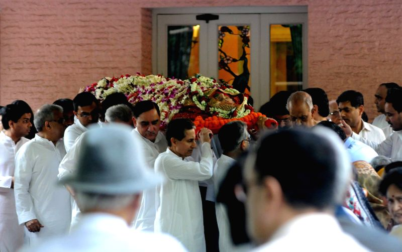 Friends and relatives at the funeral of Sarala Birla, wife of noted industrialist BK Birla in Kolkata, on March 29, 2015.