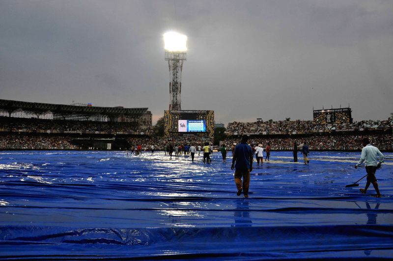 Ground staff busy drying the field at the Eden Gardens after rains disrupted an IPL-2015 match between Kolkata Knight Riders (KKR) and Rajasthan Royals (RR) in Kolkata on April 26, 2015.