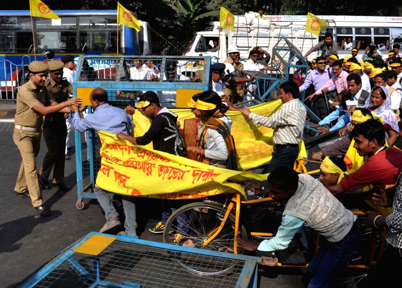 Handicapped people break police barricades during a demonstration organised on `International Day for Persons with Disabilities` in Kolkata, on Dec 3, 2014.