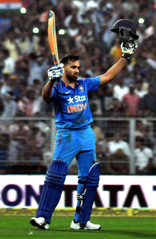 Indian batsman Rohit Sharma celebrates his double century during the 4th ODI between India and Sri Lanka at the Eden Gardens in Kolkata, on Nov 13, 2014. - Rohit Sharma