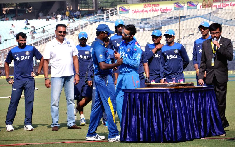 Indian captain Virat Kohli and his Sri Lankan counterpart Angelo Mathews celebrate 150 years of the Eden Gardens in Kolkata, on Nov 13, 2014. Also seen team India director Ravi Shastri. - Virat Kohli