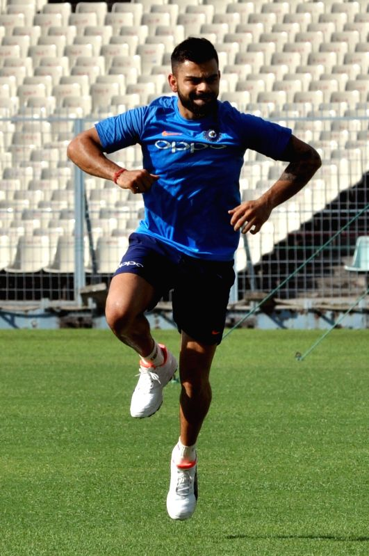 :Kolkata: Indian skipper Virat Kohli during a practice session ahead of the first test match against Sri Lanka at the Eden Gardens in Kolkata on Nov 13, 2017. .