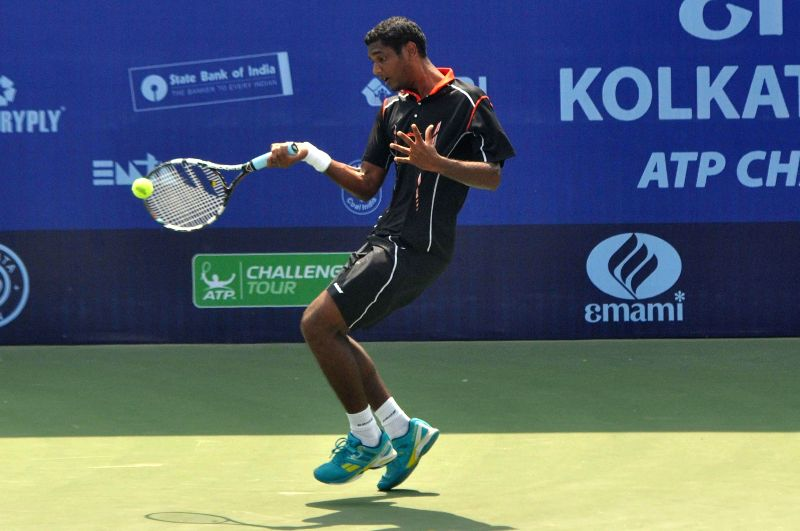 Indian tennis player Ramkumar Ramanathan in action during an Emami Kolkata Open 2015- ATP Challenger match against compatriot Somdev Devvarman on Feb 24, 2015.