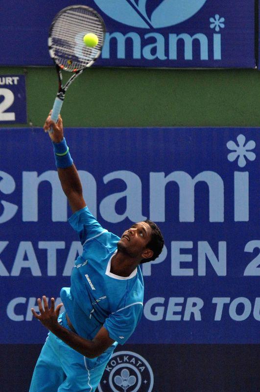 Indian tennis player Ramkumar Ramanathan in action against Serbian tennis player Miki Jankovic during an Emami Kolkata Open 2015- ATP Challenger match in Kolkata on Feb 25, 2015.