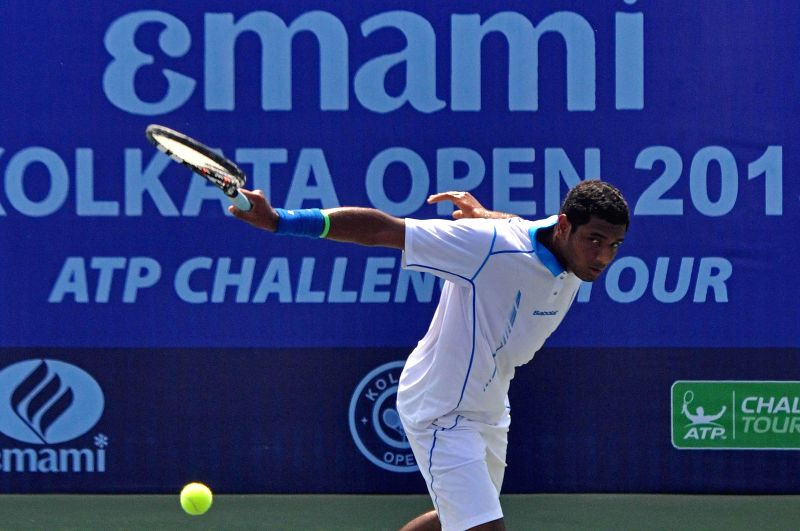 Indian tennis player Ramkumar Ramanathan in action against Chinese Taipei tennis player Chen Ti during an Emami Kolkata Open 2015- ATP Challenger match in Kolkata on Feb 26, 2015.