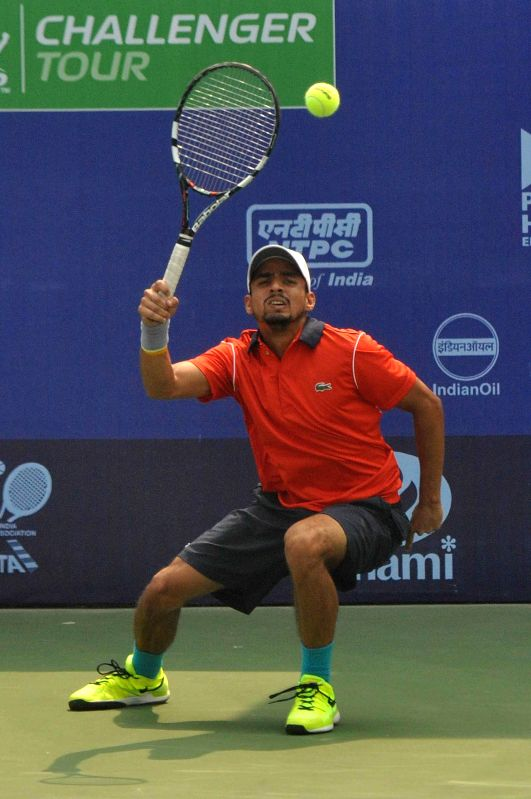 Indian tennis player Sanam Singh in action against Australian tennis player James Duckworth during an Emami Kolkata Open 2015- ATP Challenger match in Kolkata on Feb 25, 2015.