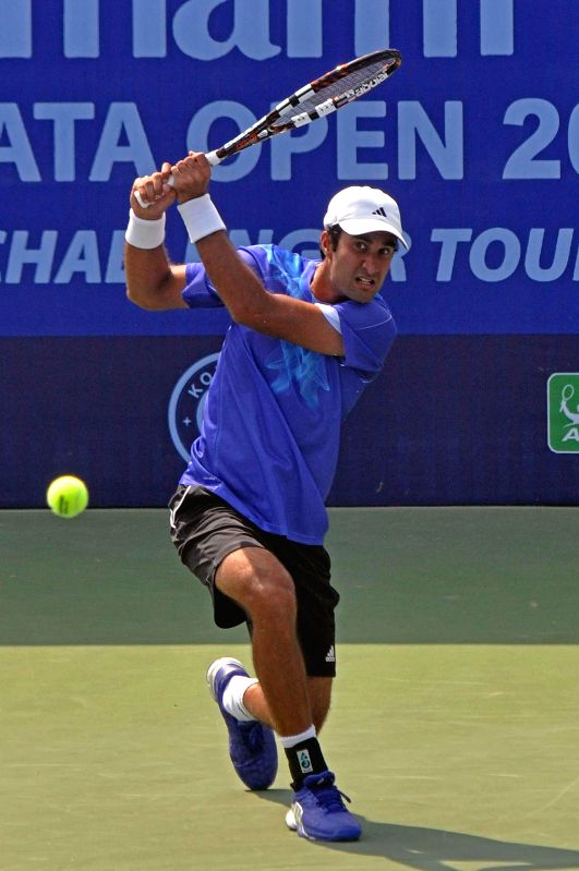 Indian tennis player Yuki Bhambri in action against Spanish tennis player Enrique Lopez-Perez during an Emami Kolkata Open 2015- ATP Challenger match in Kolkata on Feb 24, 2015.