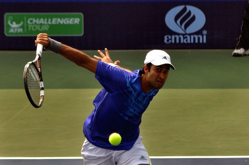 Indian tennis player Yuki Bhambri in action against Moldova tennis player Radu Albot during an Emami Kolkata Open 2015- ATP Challenger match in Kolkata on Feb 25, 2015.