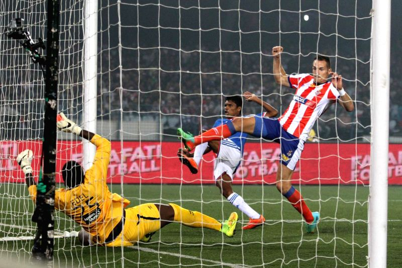 Jakub Podany, Apoula Edel and Edima Bete in action during an ISL semi-final match between Atletico de Kolkata and FC Goa in Kolkata, on Dec 14, 2014.
