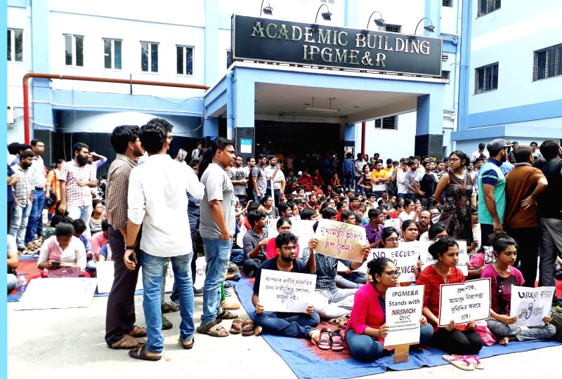 Kolkata: Junior doctors at the SSKM Hospital, who continue to be on strike for the fifth consecutive day, stage a demonstration against attacks on their colleagues and demand adequate security measures, in Kolkata on June 15, 2019.