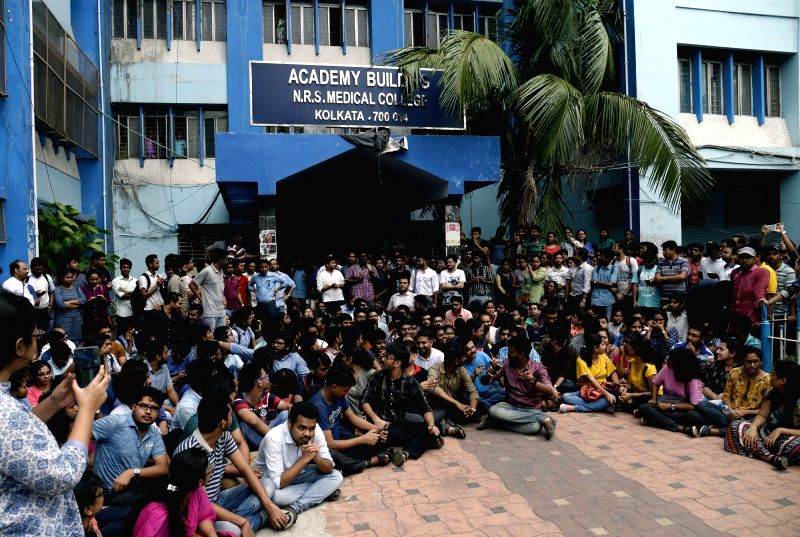 Kolkata: Junior doctors outside the NRS Medical College and Hospital, who continue to be on strike for the sixth consecutive day, staging a demonstration against attacks on their colleagues and demand adequate security measures, in Kolkata on June 16