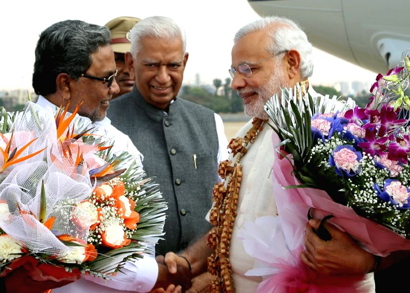 Karnataka Governor Vajubhai Rudabhai Vala  greets Chief Minister Siddaramaiah on his arrival in Bengaluru on April 2, 2015. Also seen Karnataka Governor Vajubhai Rudabhai Vala. - Siddaramaiah
