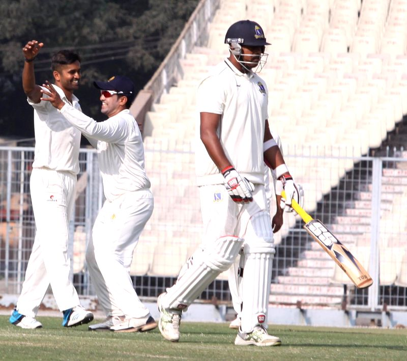 Karnataka players celebrate fall of a wicket during a match Ranji Trophy against Bengal in Kolkata, on Dec 17, 2014.