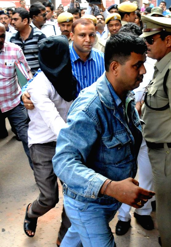 Khalid Mohammed, main accused of Burdwan blast being produce at local court by NIA official in Kolkata on Nov 20, 2014.