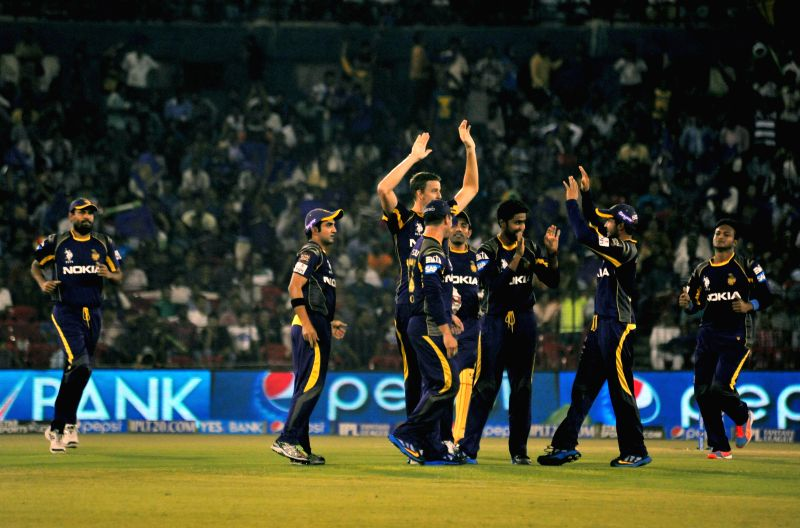 Kolkata Knight Riders celebrate fall of a wicket during the 40th match of IPL 2014 between Mumbai Indians and Kolkata Knight Riders at Barabati Stadium in Cuttack on May 14, 2014.