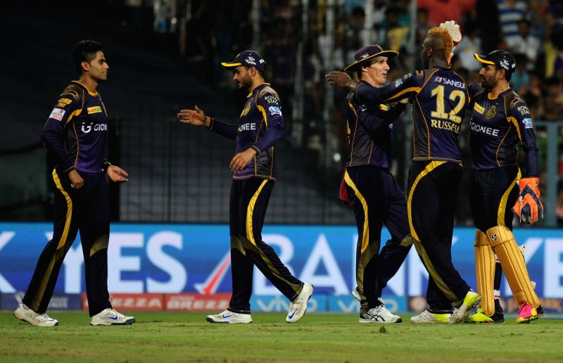 Kolkata Knight Riders celebrate fall of a wicket during an IPL match between Kolkata Knight Riders and Gujarat Lions at Eden Gardens in Kolkata, on May 8, 2016.