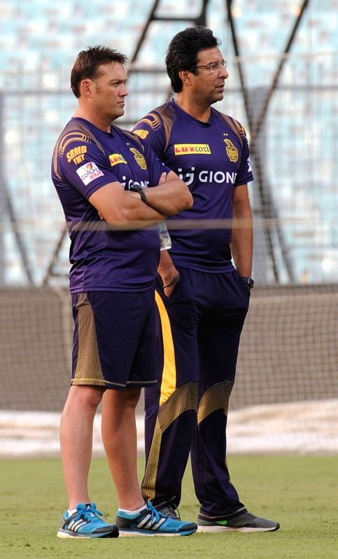 Kolkata Knight Riders coaches Jacques Kallis and Wasim Akram during a practice session at Eden Gardens in Kolkata on May 13, 2016.