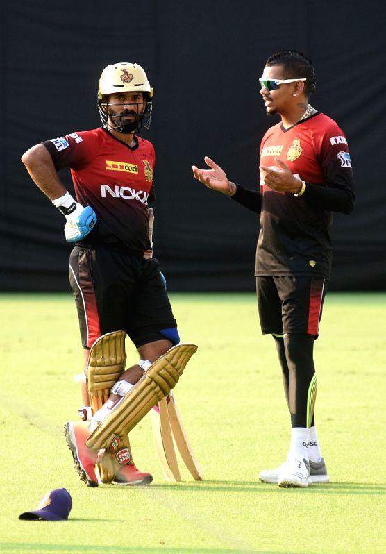 Kolkata Knight Riders (KKR) captain Dinesh Karthik with Sunil Narine during a practice session at Eden Gardens in Kolkata, on April 13, 2018. - Dinesh Karthik