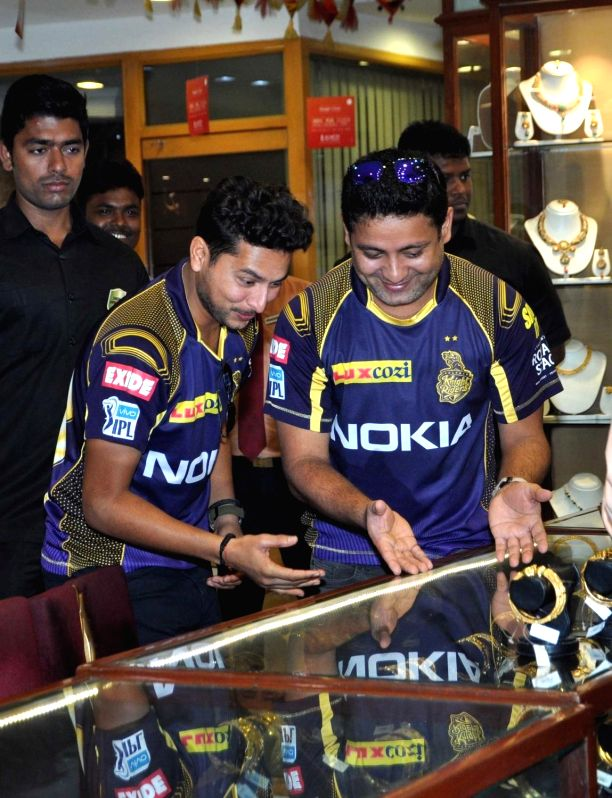 Kolkata Knight Riders (KKR) players Kuldeep Yadav and Piyush Chawla during a promotional programme in Kolkata on April 13, 2018. - Kuldeep Yadav