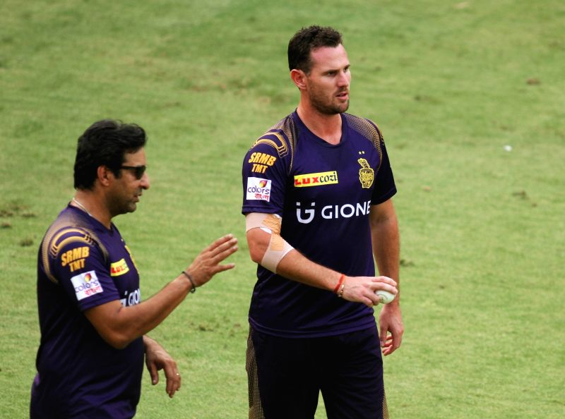 Kolkata Knight Riders player Shaun Tait and coach Wasim Akram during a practice session at Feroz Shah Kotla Stadium, in New Delhi on May 24, 2016.