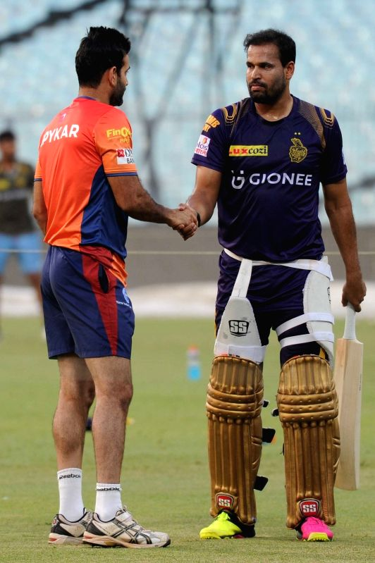 Kolkata Knight Riders player Yusuf Pathan (R) with his brother Irfan Pathan (L) of Rising Pune Supergiants during a practice session at Eden Gardens in Kolkata on May 13, 2016.