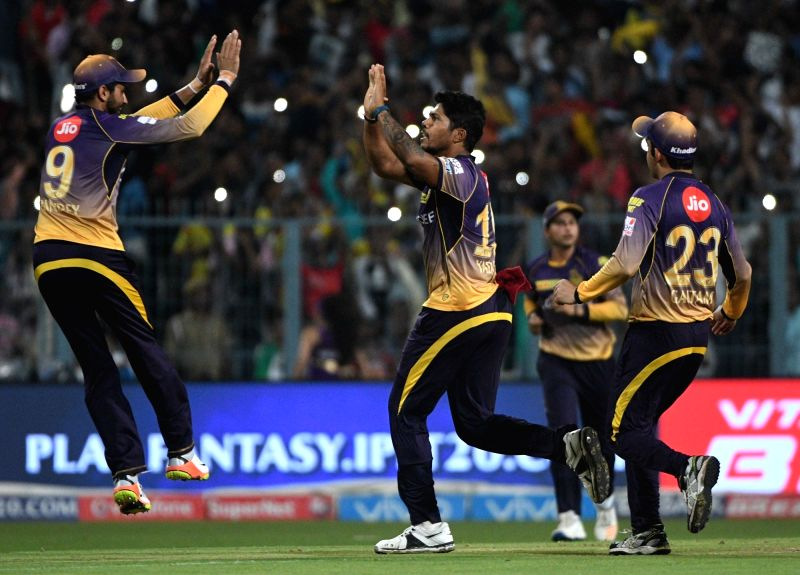 Kolkata Knight Riders players celebrate fall of Dwayne Smith's wicket during an IPL 2017 match between Kolkata Knight Riders and Gujarat Lions at Eden Gardens in Kolkata, on April 21, 2017.