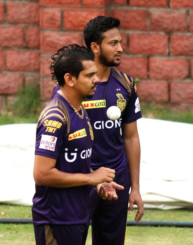 Kolkata Knight Riders players Sunil Narine and Shakib al Hasan during a practice session at Feroz Shah Kotla Stadium, in New Delhi on May 24, 2016.