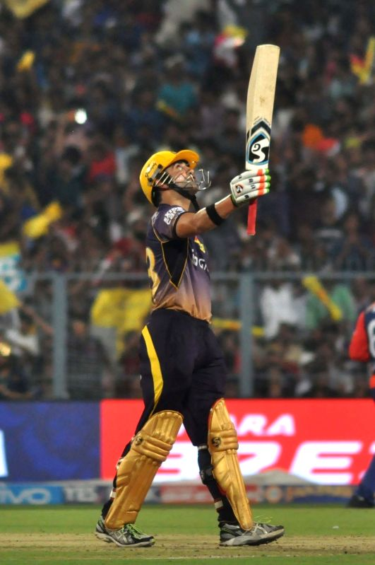 Kolkata Knight Riders skipper Gautam Gambhir celebrates his half century during an IPL 2017 match between Kolkata Knight Riders and Delhi Daredevils at Eden Gardens in Kolkata on April 28, ...