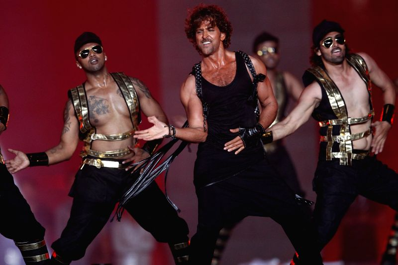 Kolkata: Actor Hrithik Roshan performs during the Pepsi IPL 2015 opening ceremony at the Salt Lake Stadium in Kolkata on April 7, 2015. - Hrithik Roshan